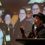 Mani speaks about the early days of ISNA - the Intersex Society of North America. She is depicted with fellow ISNA members in the slide behind her. ISNA's intersex membership was later thrown out of the organization when Bo Laurent aka Cheryl Chase and Alice Dreger aided and abetted the pathologization of intersex by creating the DSD concept - Disorders of Sex Development - and turned ISNA into the Accord Alliance, betraying ISNA's original ideals. Laurent aka Chase is at far left. Photograph © copyright Angela Erde 2010.